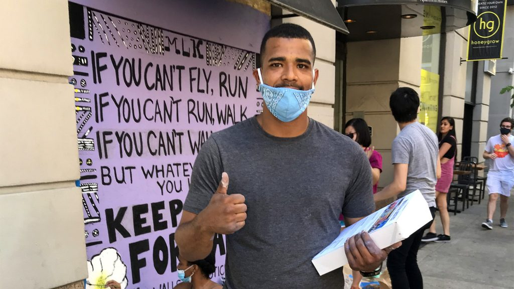 Walls for Justice founder Samuel Rodriguez outside Philly Runner