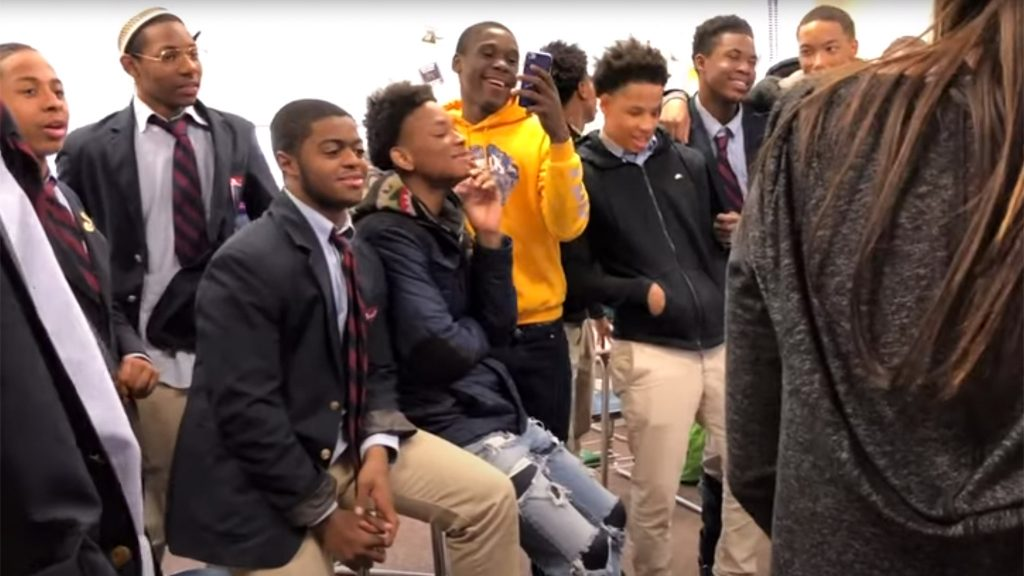 Students at Boys' Latin of Philadelphia Charter School sing together in memory of a lost friend