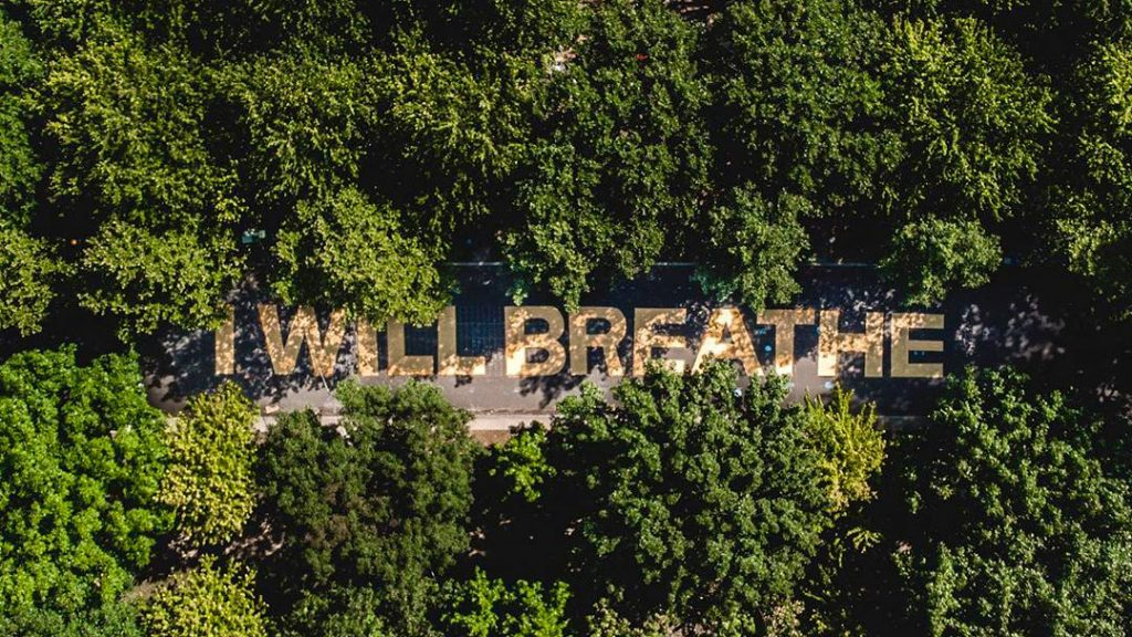 Activists painted a new street mural on the Ben Franklin Parkway near the encampment
