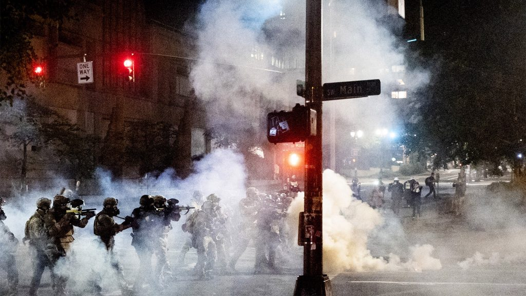 Federal agents use crowd control munitions to disperse Black Lives Matter protesters near the Mark O. Hatfield United States Courthouse on Monday, July 20, 2020, in Portland, Ore.