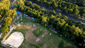 The encampment at Von Colln Field on the Ben Franklin Parkway, seen from above in late July