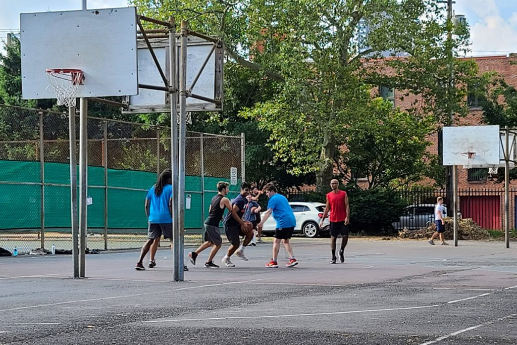 A group of friends plays basketball in South Philadelphia in late July