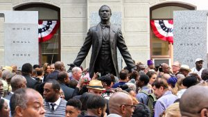 An crowd surrounds the statue of Octavius Catto after its unveiling on the Southwest apron of Philadelphia City Hall in 2017