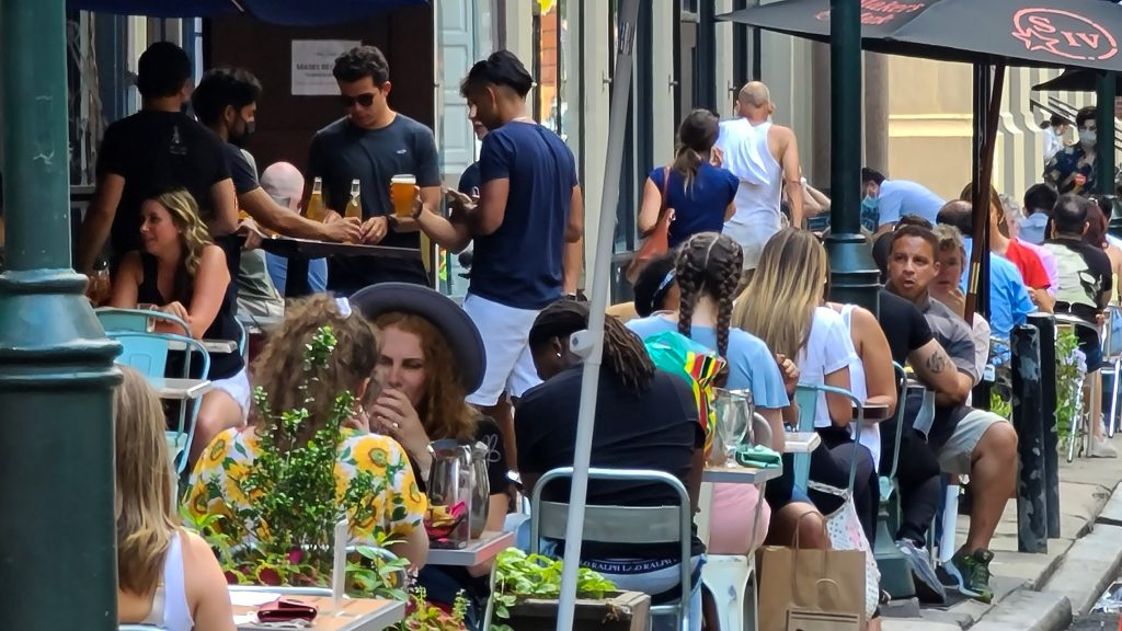 Diners at a Center City restaurant in late July. Masks are not mandatory when you're sitting at a table.