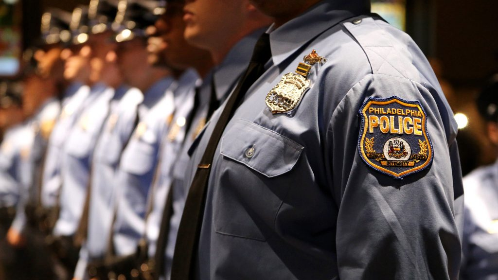 Police academy cadets line up for graduation in 2017