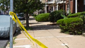 Tape left near 10th and Brown in North Philadelphia, where 5 were wounded in a shooting after a block party