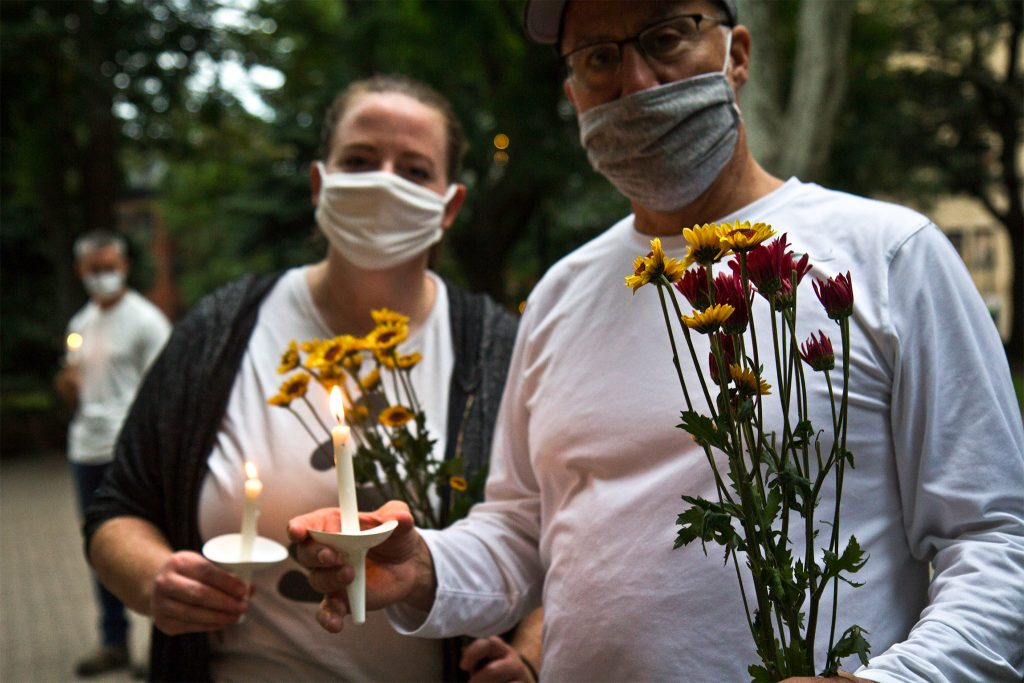 Friends of Sarah Pitt lit candles and carried flowers at Rittenhouse Square park in Philadelphia for a vigil and a march in her honor