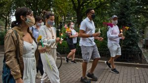Friends of Sarah Pitt carried flowers in her honor at a vigil that started in Rittenhouse Square