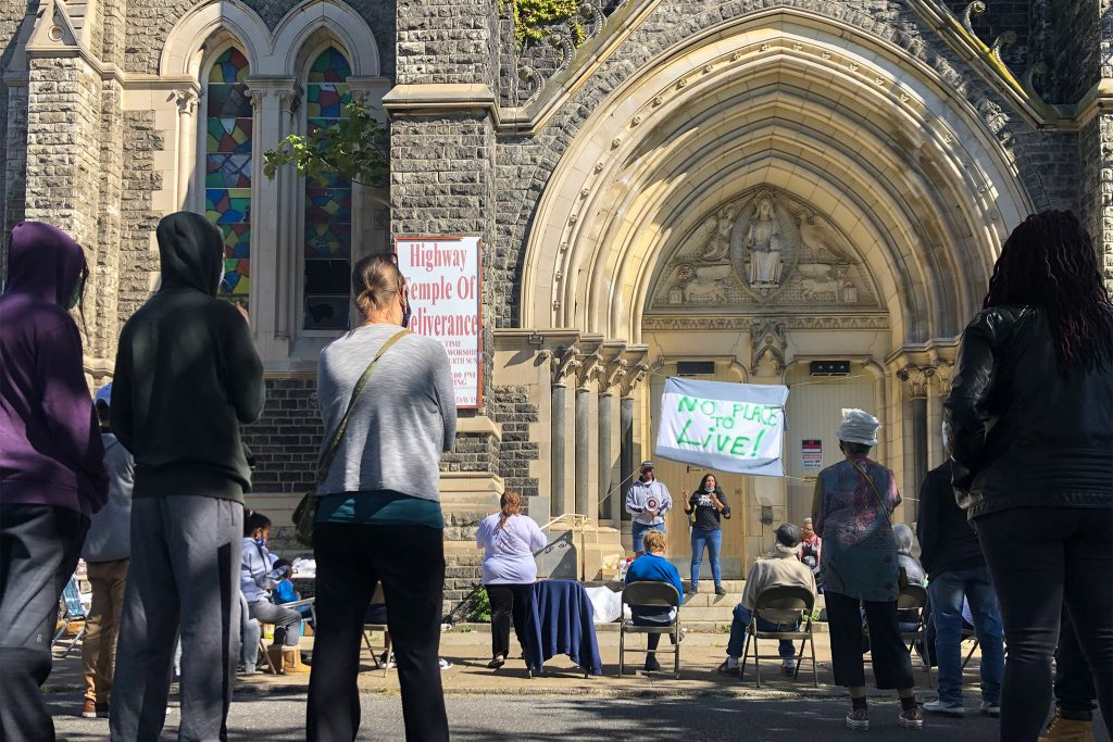 Activists gather in the chapel of the former St. Edward's church on Sunday afternoon, 25 years after occupying the space for the first time.