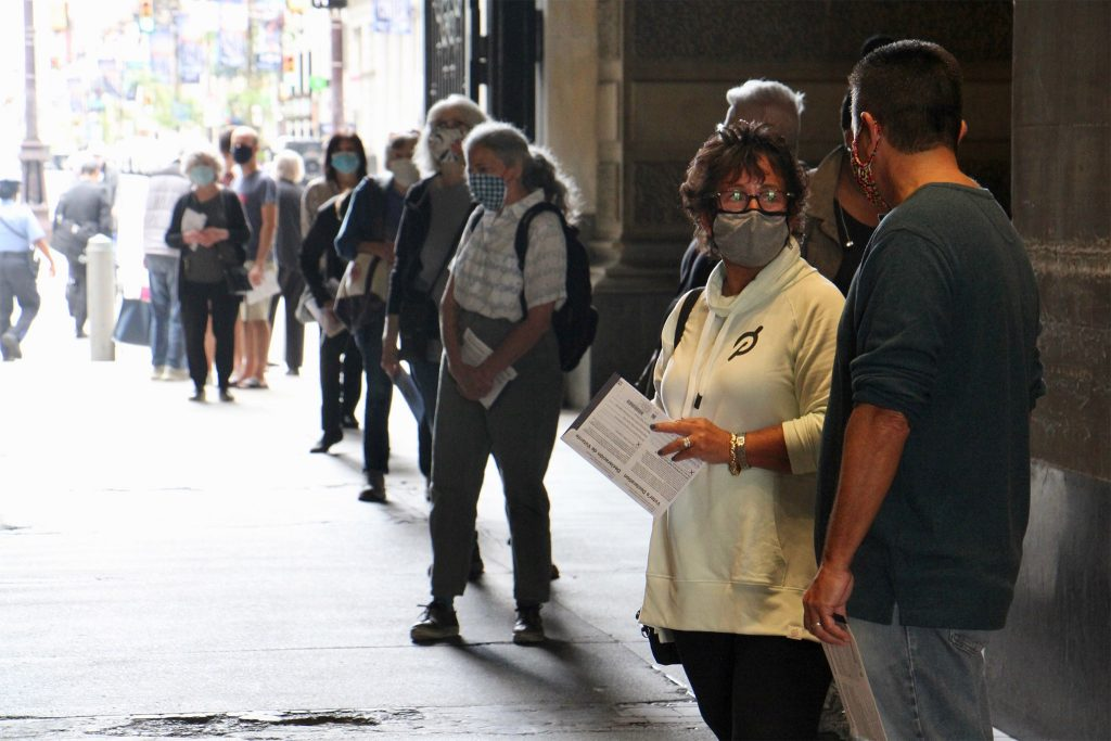 Voters line up at Philadelphia City Hall to drop off their mail in ballots in October 2020