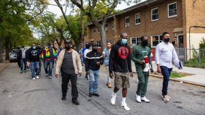 Members of the Richard Allen, Penn Town and Harrison housing communities held a 'Put the Guns Down' peace walk through their neighborhood in October 2020