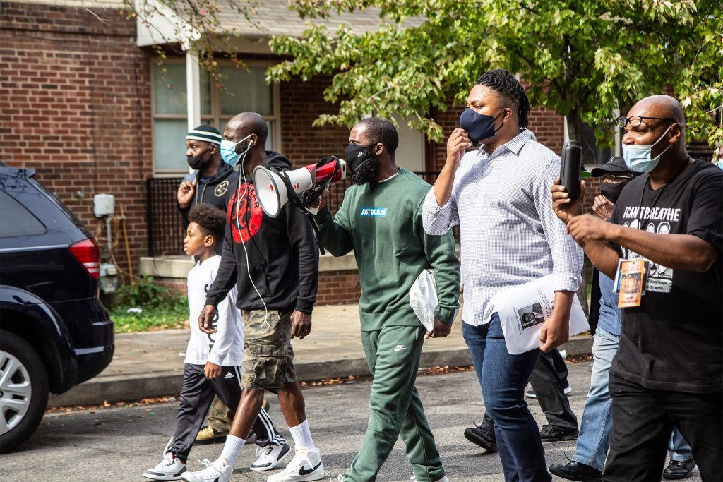 State Rep. Malcolm Kenyatta (second from right) and other community leaders at Saturday's peace walk