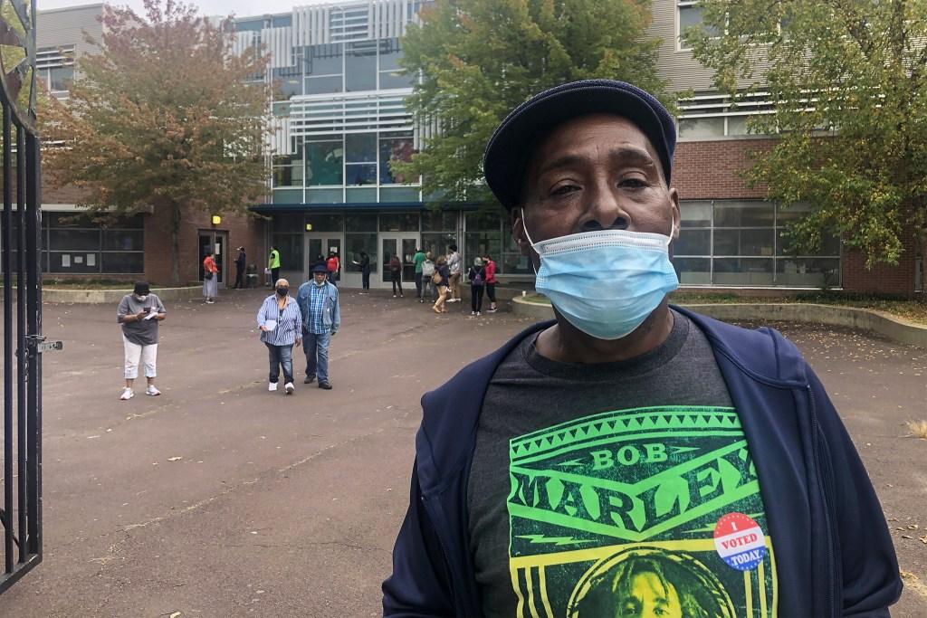 Kensington resident James Lipscomb, 64, emerges from voting at the De Burgos school.