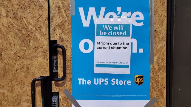 A boarded up UPS Store at 13th and Chestnut closed early Wednesday