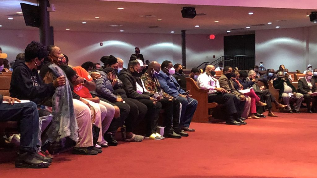 Family of the late Walter Wallace Jr. fill the front row of a community meeting inside a church, the day after he was shot to death by police