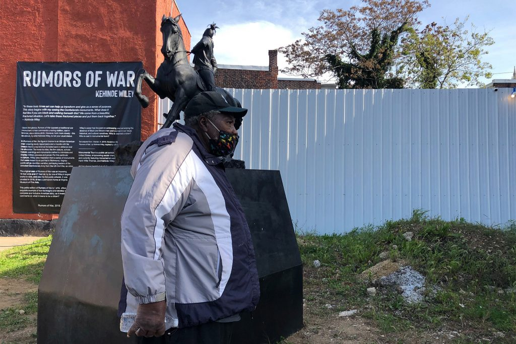 Fletcher Street Urban Riding Club President and Founder Ellis Ferrell, 81, visited artist Kehinde Wiley's Rumors of War sculpture at 52nd and Locust streets
