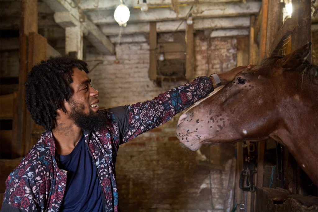 Jamil Prattis, who's known Ferrell for two decades, pets his favorite horse,100