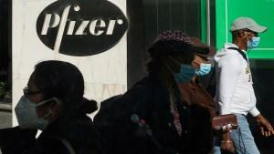 Pedestrians walk past Pfizer world headquarters