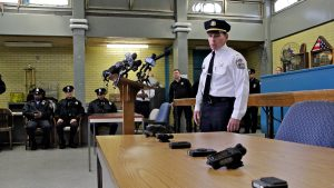 Then-Lt. Tom McLean displays displaying new Philly police equipment in 2014