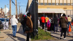 People stood in line outside Sayre Health Center in West Philly for COVID testing a week before Thanksgiving