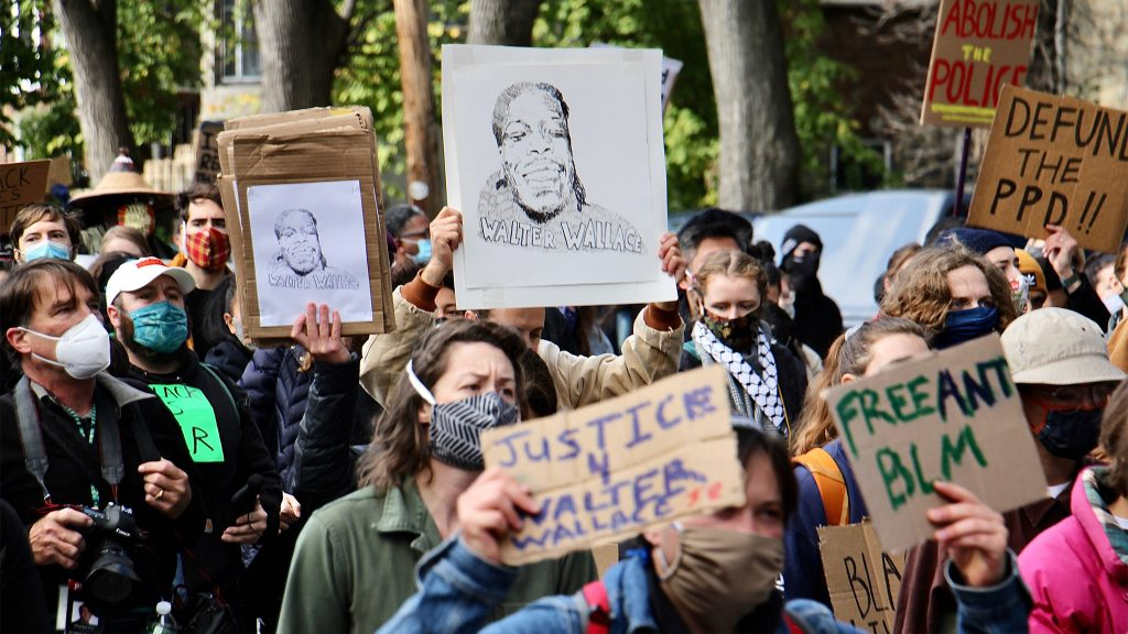 Protesters carry likenesses of Walter Wallace Jr. during a march against police violence in West Philadelphia