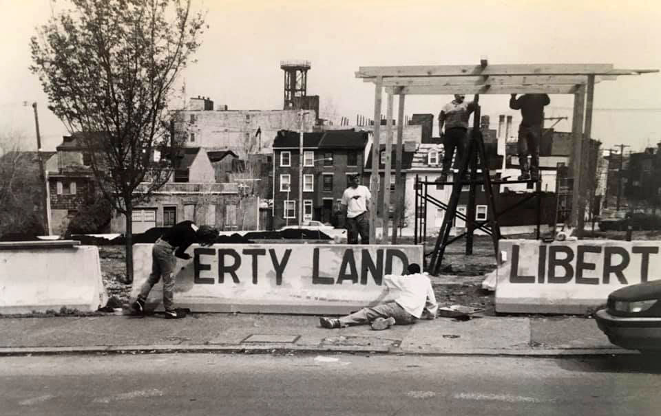 Neighbors work in 1998 on what will eventually become Liberty Lands Park