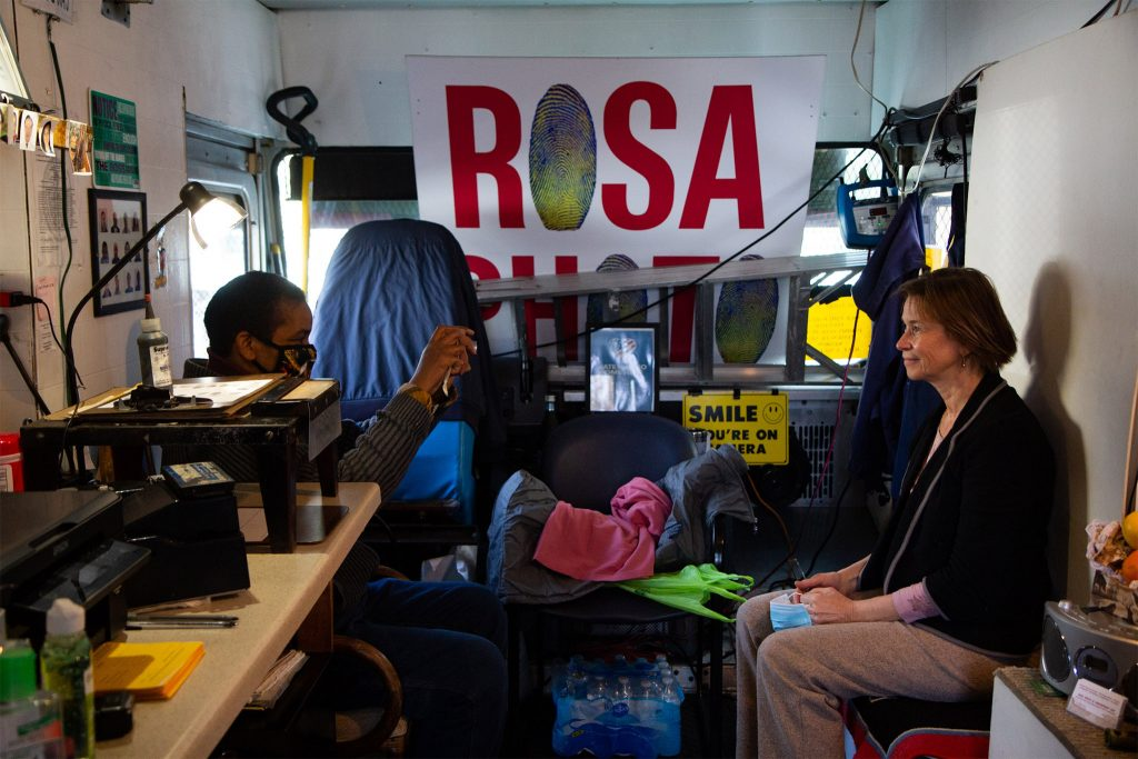 Barbara Jackson takes a pic of Natalia, who got her first photograph at Rosa's in 2001 for a work visa