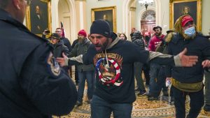 Trump supporters gesture to U.S. Capitol Police in the hallway outside the Senate chamber