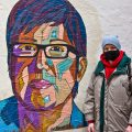 Tiff Urquhart and her new wheatpaste of late LGBTQ activist Gloria Casarez, installed down the block from the whitewashed Casarez mural