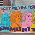 Artists Tisha Golafaie (left) and Symone Salib (right) with their 'We Did That' mural