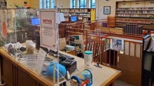 COVID-protective plexiglass barriers at a West Philly branch of the Free Library