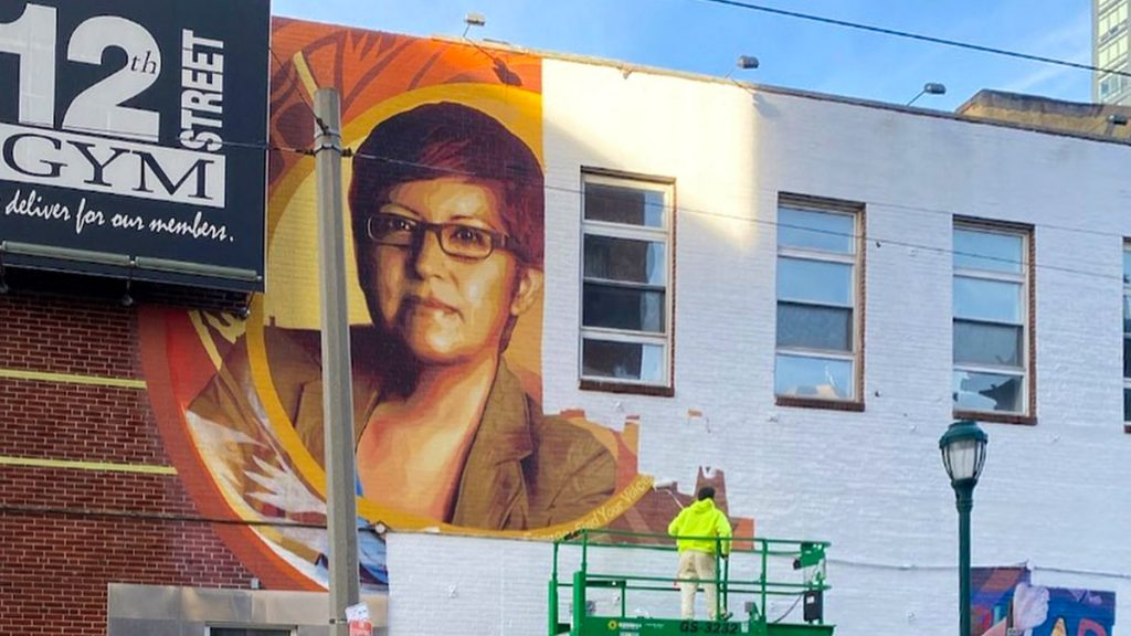 The Gloria Casarez mural as it was being erased on Dec. 23