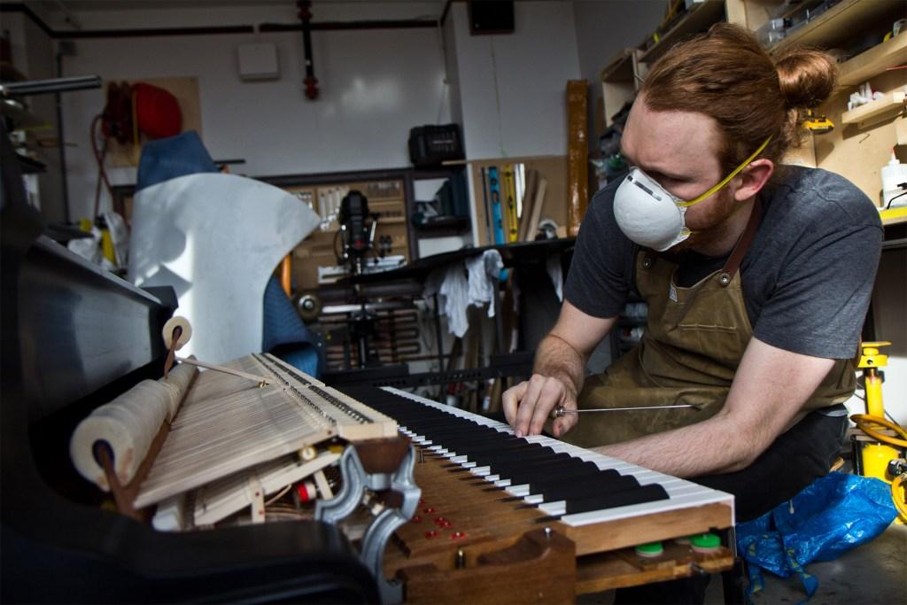 Tom Rudnitsky at work in his Philatuner Piano Works studio in the Bok building