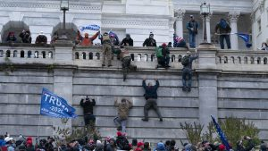 Insurrectionists supporting President Donald Trump climb the west wall of the the U.S. Capitol on Wednesday