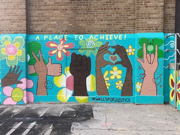 A Walls for Justice mural on a Philly school, placed with the help of @jellytoastin