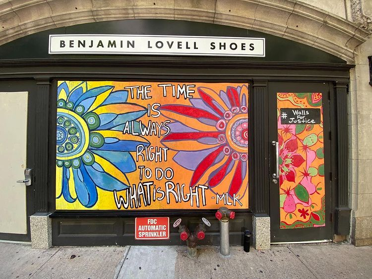 Some businesses collaborated with Walls for Justice on custom storefront murals