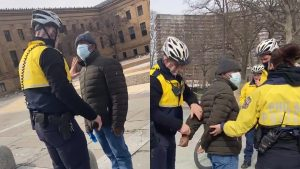 A swarm of Philadelphia police officers arrest a man they accused of soliciting money in return for photos outside the Philadelphia Museum of Art