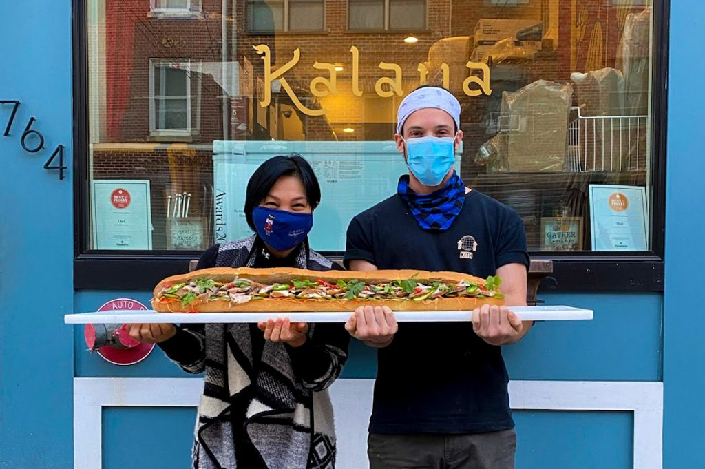 "Kalaya chef-owner Chutatip ""Nok"" Suntaranon and sous ChefxJeff hold their oversize pork belly hoagie"