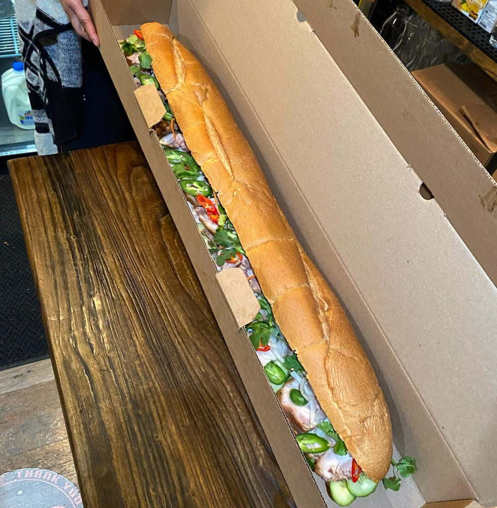 The 3-foot banh mi came in a 3-foot hoagie box
