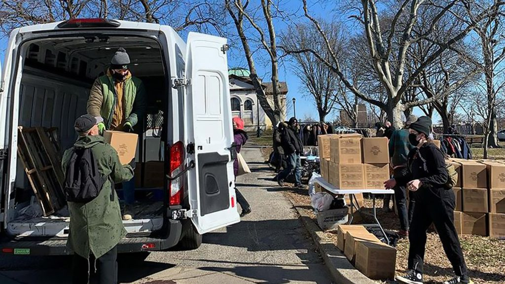 Volunteers with City Wide Mutual Aid at a delivery of groceries and food in Kensington in late January