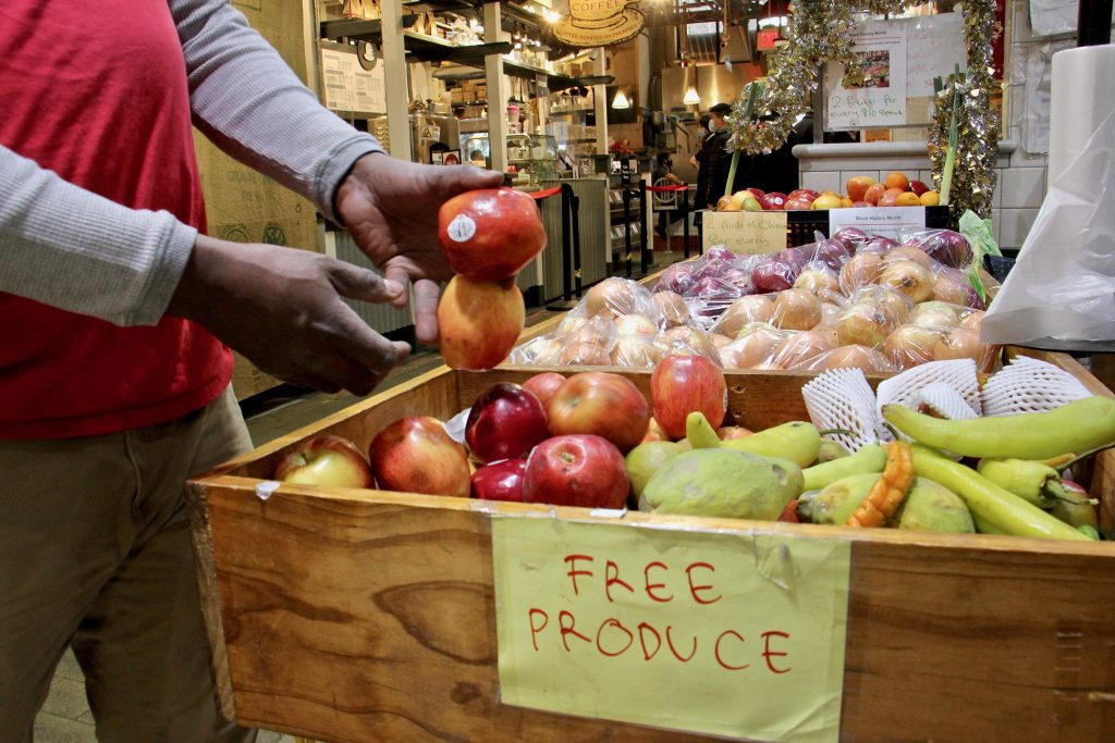 """OK Produce has a """"free produce"""" table giving away slightly bruised or blemished fruits and vegetables that might not otherwise sell"""