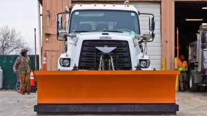 The Streets Department converts sanitation trucks into snow plows when needed