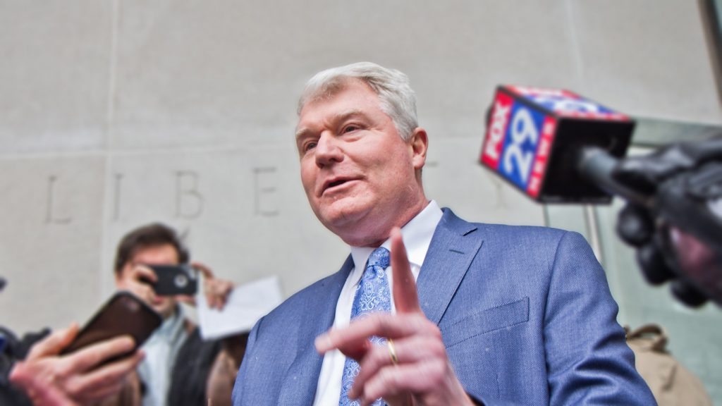 John Dougherty exits federal court after pleading not guilty at a 2019 arraignment