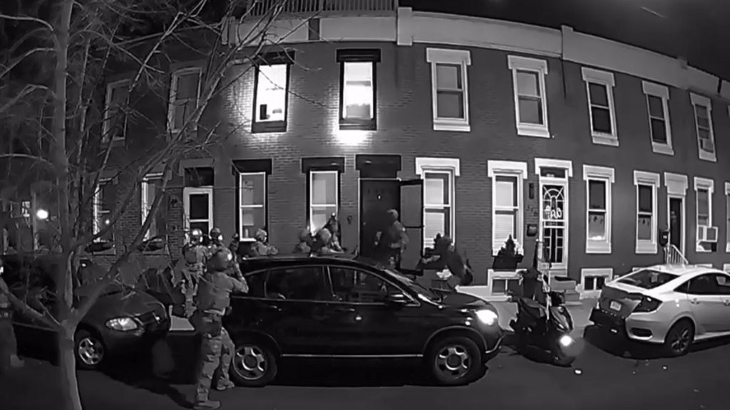 Agents outside the house of Gregory Fiocca and family in South Philadelphia on March 3