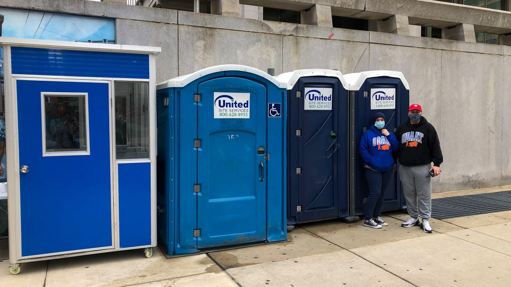 One Day At A Time employees Terri Wagner and John Smutnik staff the trio of porta-potties at their new 15th and Arch location