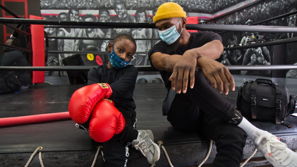 8 year-old King Lewis hangs with Maleek Jackson at his boxing gym in Northern Liberties