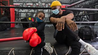8 year-old Lewis King hangs with Maleek Jackson at his boxing gym in Northern Liberties