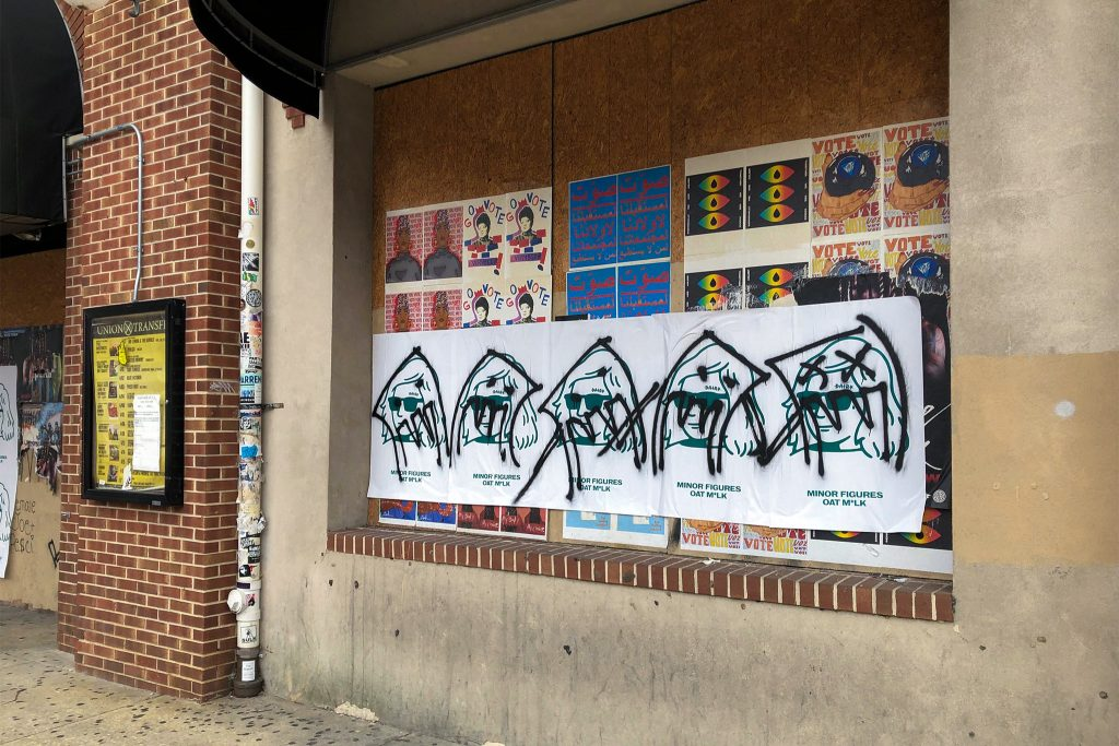 The ads were treated to a graffiti scrawl, unlike artwork that's been up and untouched for months
