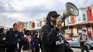 Community activist Isaac Gardner, shown here leading a march in October 2020, runs Unsolved Murders in Philly, one of the organizations in the new program