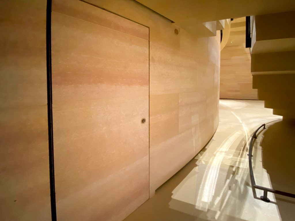 A closet is tucked beneath the Gehry stairs in the Williams Forum